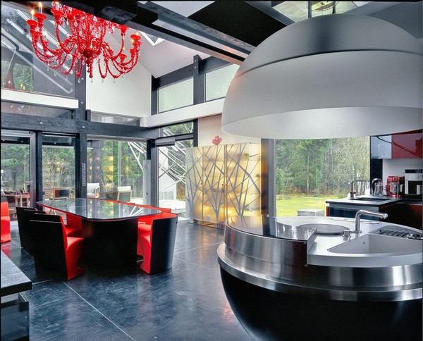 1-unusual-glass-house-panoramic-windows-open-plan-concept-kitchen-living-room-unusual-round-ball-shaped-kitchen-island-red-dining-table-red-chandelier