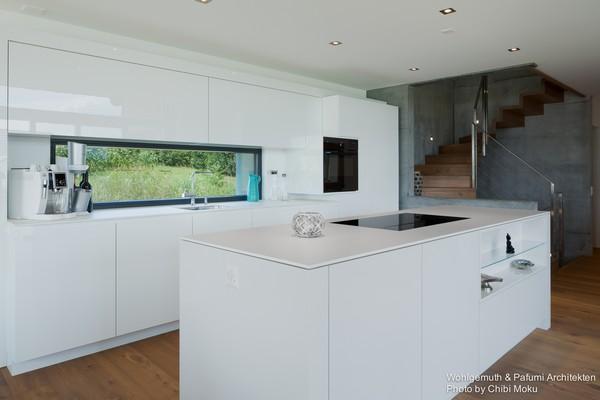 10-swiss-minimalist-modern-white-open-concept-kitchen-island