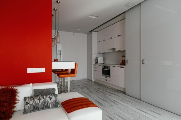 11-white-open-concept-living-room-kitchen-red-walls