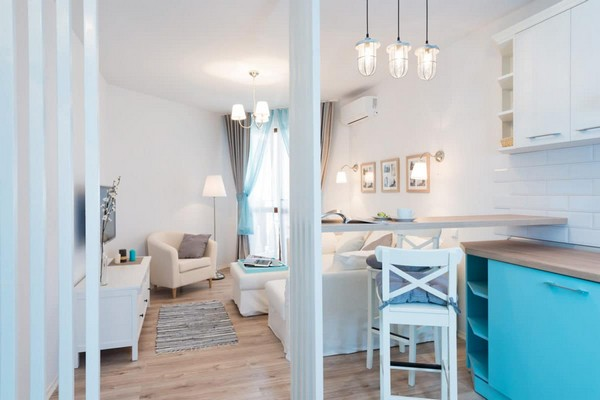 2-fresh-and-airy-white-and-blue-studio-apartment-interior-design-wooden-partitions-bar-table-stool