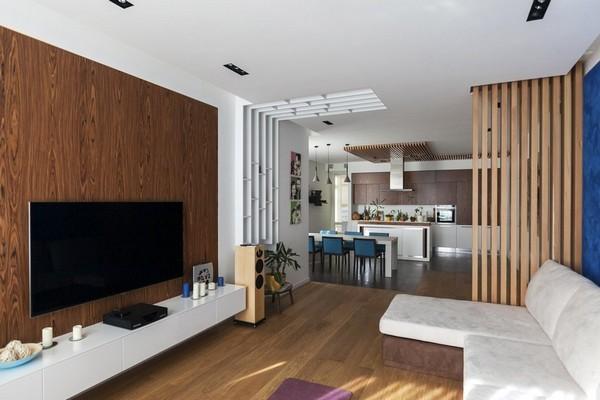 2-minimalist-style-interior-open-concept-living-room-white-sofa-wooden-decor-designer-book-shelves