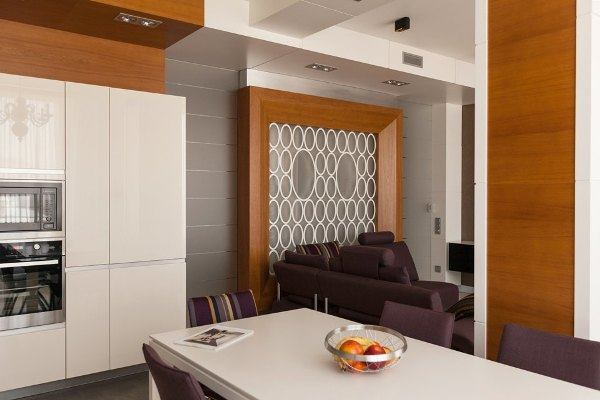 2-minimalist-style-open-concept-living-room-kitchen-purple-sofa-and-chairs-load-bearing-columns-white-dining-table-frosted-glass-sliding-doors