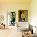 2-non-white-painted-colorful-yellow-ceiling-in-the-living-room-whote-sofa-artwork