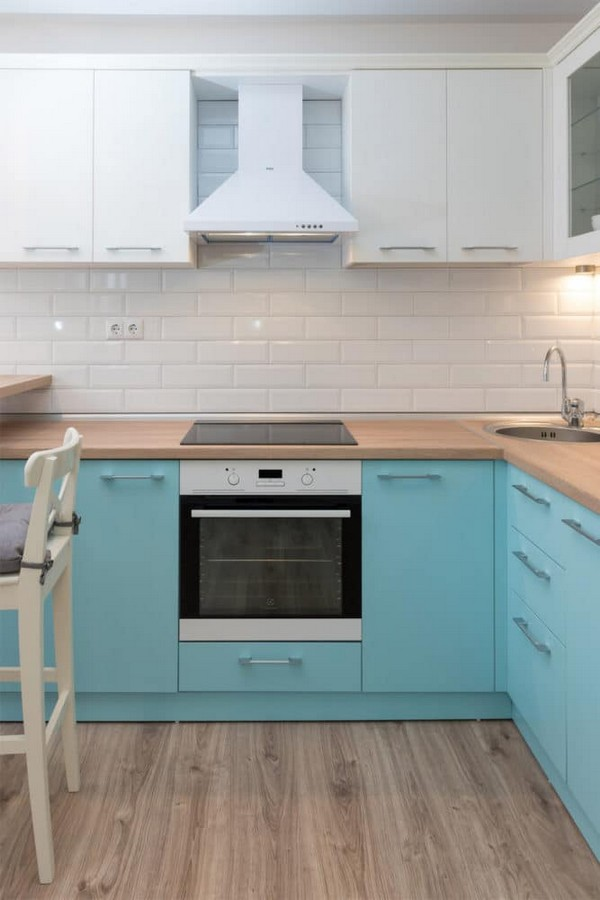 3-fresh-and-airy-white-and-blue-studio-apartment-interior-design-brick-tiles-kitchen-set