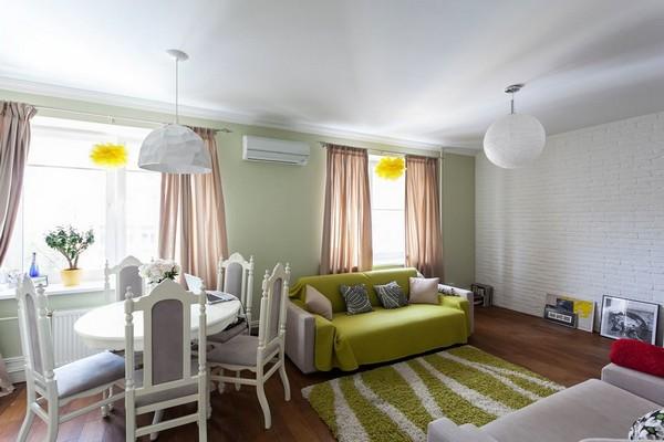 4-english-interior-style-open-concept-living-room-white-kitchen-green-sofa-ball-lamp-shaggy-rug-carpet-pastel-green-walls-brick-wall-dining-set
