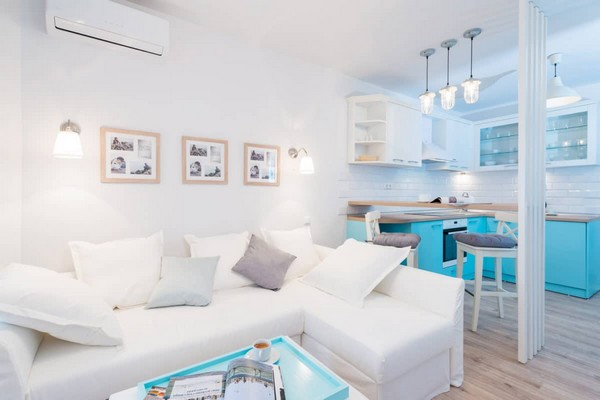 4-fresh-and-airy-white-and-blue-studio-apartment-interior-design-bar-table-wooden-partition-big-folding-IKEA-sofa
