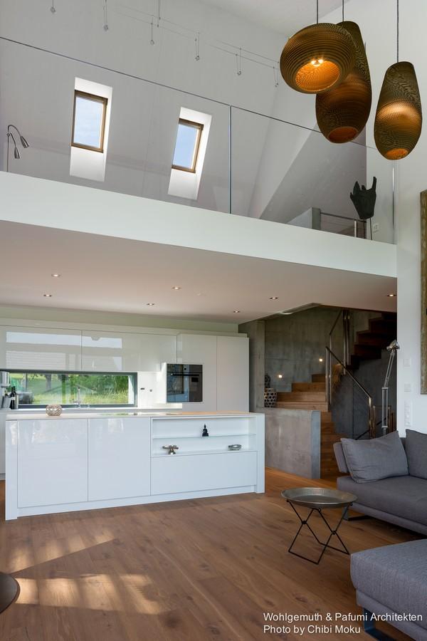 4-swiss-minimalist-modern-open-concept-living-room-white-kitchen-galleria