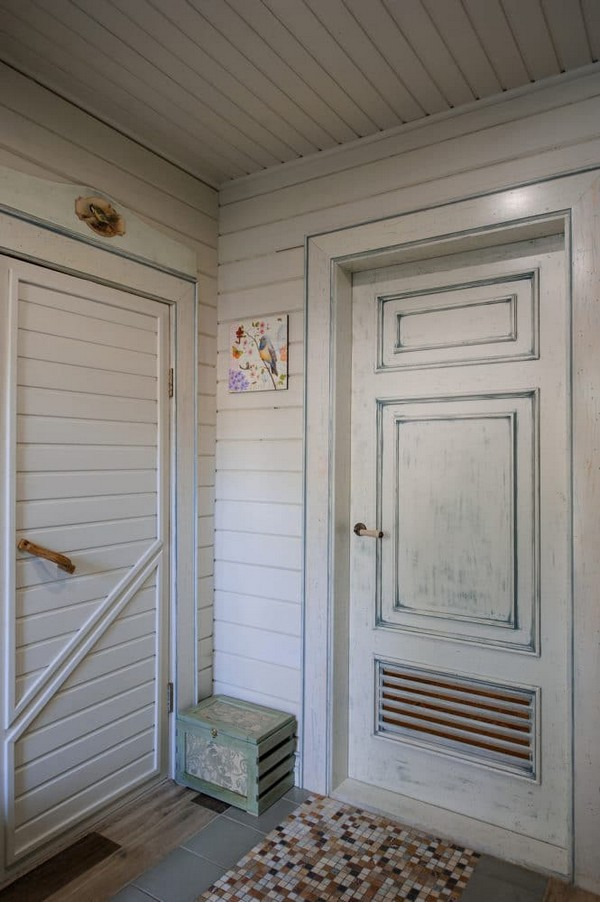 4-vintage-style-beige-and-turquoise-sauna-interior-entry-room-bird-theme-decor-pattern-aged-door-with-vent-grilles-decoupaged-furniture-mixed-tiles-mosaics-ceramic-flooring-wooden-walls