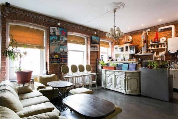 5-creative-interior-design-artist's-apartment-studio-artworks-paintings-loft-style-open-concept-living-room-kitchen-brick wall