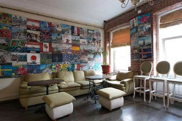6-creative-interior-design-artist's-apartment-studio-artworks-paintings-loft-style-brick-wall-sofa-chairs-sitting-funriture