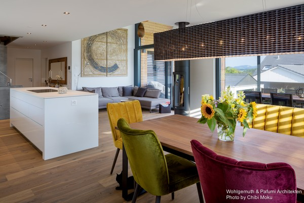 6-swiss-minimalist-modern-open-concept-living-room-dining-room-kitchen-island-mismatched-multicolor-dining-chairs-gray-sofa