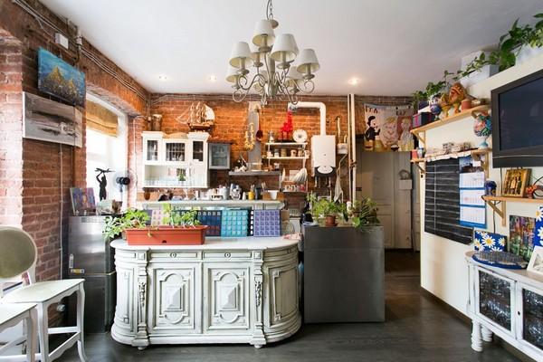 7-creative-interior-design-artist's-apartment-studio-artworks-paintings-loft-style-open-concept-living-room-kitchen-brick wall