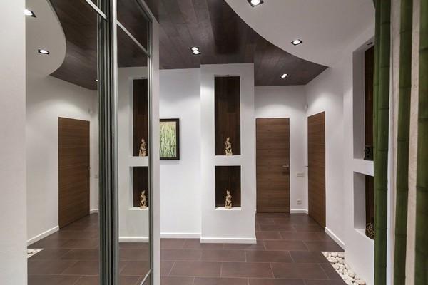 7-minimalist-style-interior-bamboo-pebbles-wall-niches-hallway