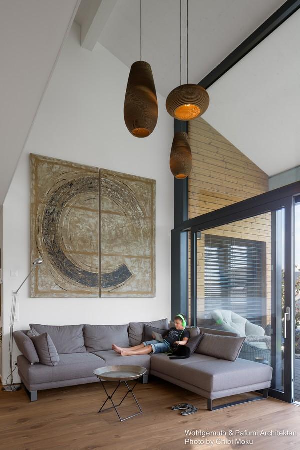 8-swiss-minimalist-modern-living-room-big-gray-corner-sofa-panoramic-windows