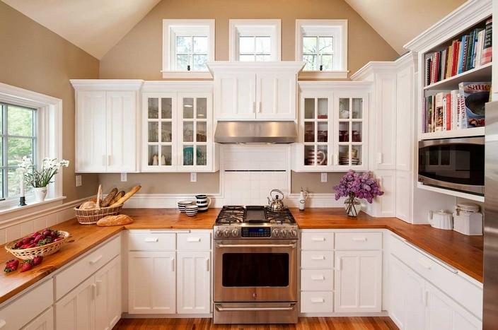 8-white-kitchen-glass-cabinets-oak-tabletop-floor