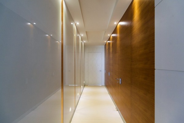 9-minimalist-style-hallway-floor-tiles-narrow-wood-planks-white-glossy-walls-invisible-doors