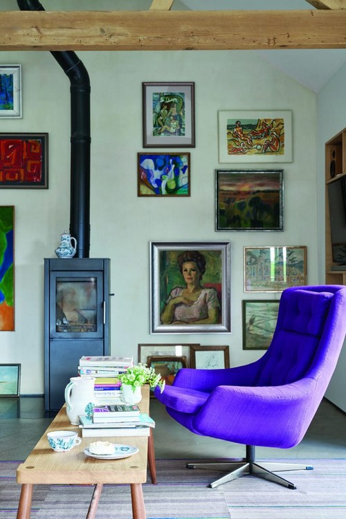 9-trendy-interior-color-spring-2017-farrow-and-ball-all-white-wall-color-painting-artworks-purple-arm-chair-fireplace