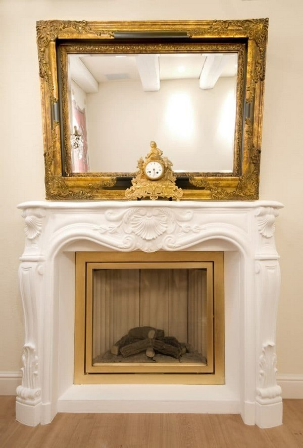 9-world's-smallest-hotel-guinness-book-records-white-classical-fireplace-gold-plated-mirror