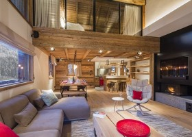 0-chalet-style-interior-design-stone-wood-open-plan-living-room-dining-kitchen-with-red-accents-fireplace-gray-sofa-big-windows-winter-mountain-view