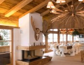 Wooden House in Chalet Style with Fairy-Tale Scenes