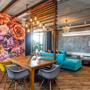 0-mixed-style-brutal-loft-pop-art-eco-style-apartment-interior-design-ceiling-faux-concrete-walls-open-wiring-wooden-planks-open-plan-living-room-kitchen-dining-room-floral-wall-mural-bright-blue-velvet-sofa