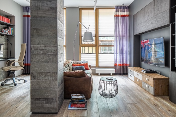 1-gray-loft-style-bachelor's-apartment-interior-design-open-plan-living-room-work-area-load-bearing-column-laminate-flooring-gray-tiles