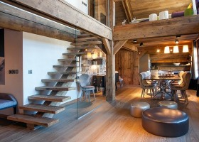 1-total-wooden-chalet-style-apartment-interior-design-console-stairs-open-to-below-second-floor-big-round-leather-ottomans