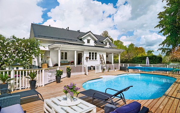 1-white-and-gray-Scandinavian-style-wooden-house-adjacent-outdoor-territory-solarium-swimmin-pool
