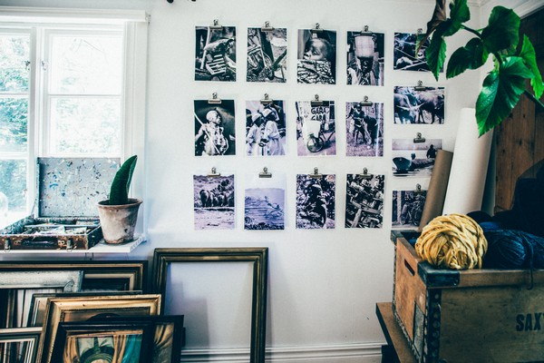 12-Scandinavian-Sweden-bohemian-boho-chic-style-interior-design-workshop-artist's-black-and-white-photos-on-the-wall