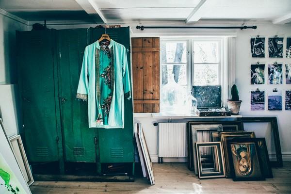 13-Scandinavian-Sweden-bohemian-boho-chic-style-interior-design-decor-green-wooden-wardrobe-picture-frames