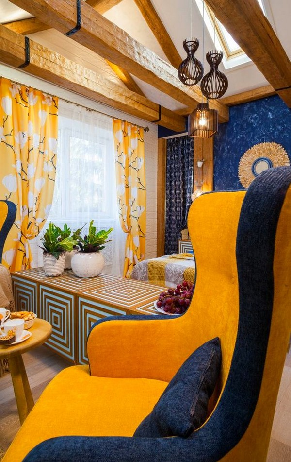 2-cheerful-blue-yellow-white-attic-bedroom-interior-design-ceiling-beams-arm-chairs-skylight