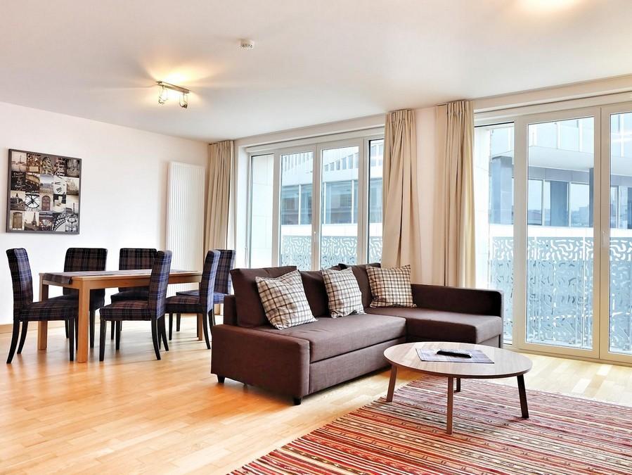 2-minimalist-contemporary-living-room-interior-design-sofa-dining-table-chairs-stripy-carpet-panoramic-windows