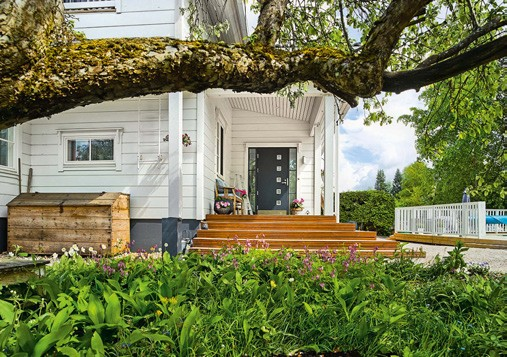 2-white-and-gray-Scandinavian-wooden-house-terrace-porch-entrance-door
