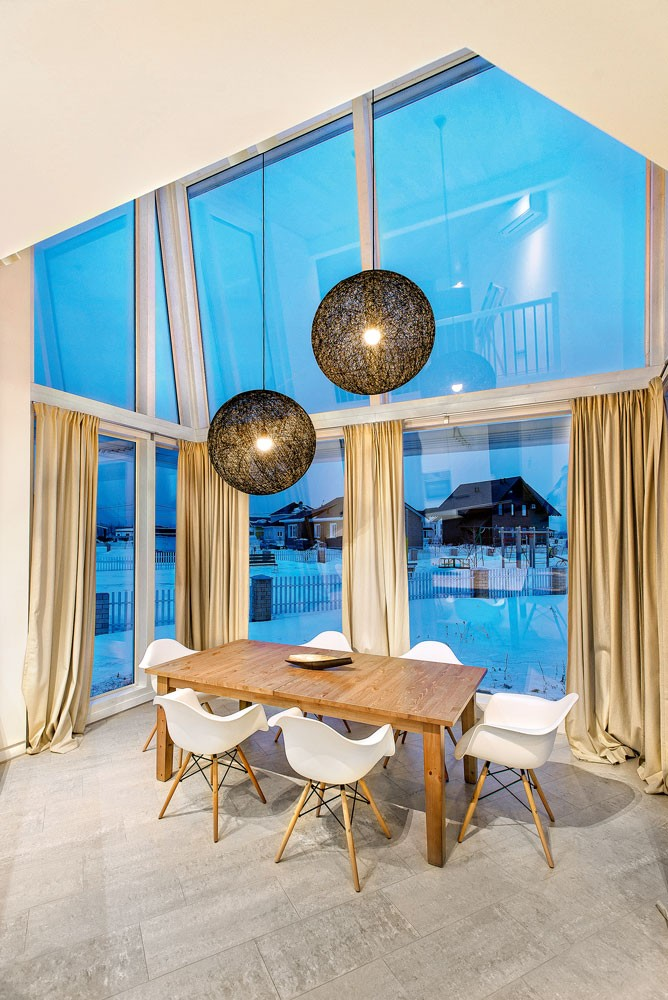 2-white-beige-and-gray-minimalist-Scandinavian-style-house-interior-design-black-pendant-lamps-dining-room-panoramic-windows-curtains-wooden-table