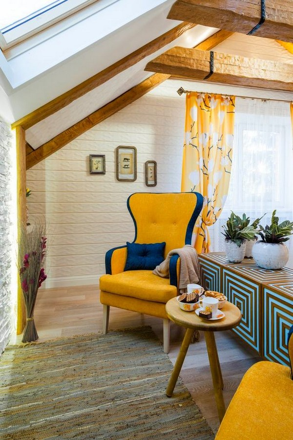 22-cheerful-blue-yellow-white-attic-bedroom-interior-design-ceiling-beams-artificial-stone-fireplace-surround-leather-mat-arm-chairs-small-coffee-table-3D-walls-skylight