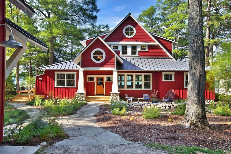 3-beautiful-red-house-with-mismatched-windows-of-different-size-in-the-forest