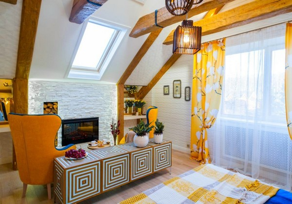 3-cheerful-blue-yellow-white-attic-bedroom-interior-design-ceiling-beams-3D-walls-artificial-stone-fireplace-surround-skylight