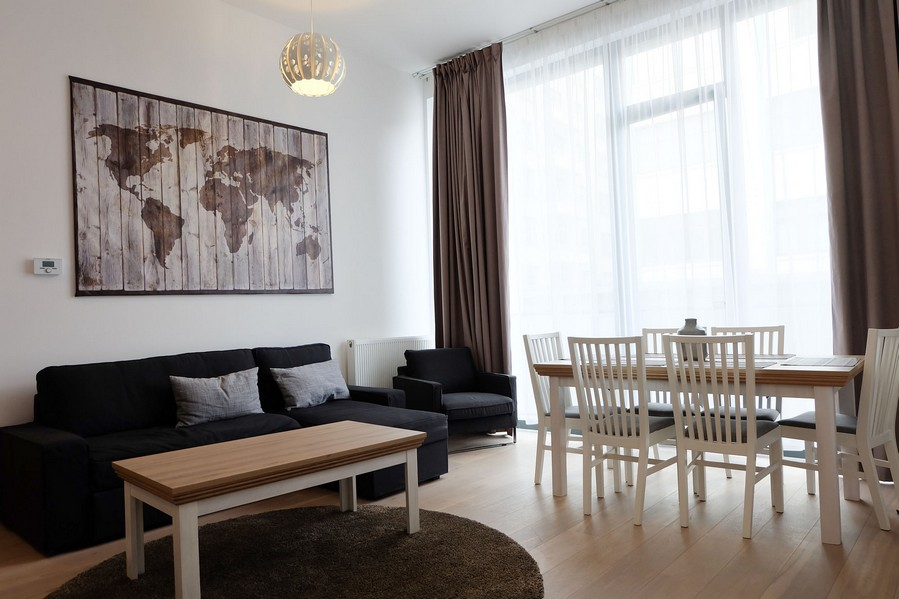 3-minimalist-contemporary-living-room-interior-design-sofa-dining-table-chairs-roung-carpet-rug-panoramic-windows-coffee-table-world-map-on-the-wall