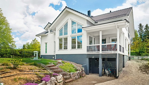 3-white-and-gray-Scandinavian-style-wooden-house-with-basement-floor