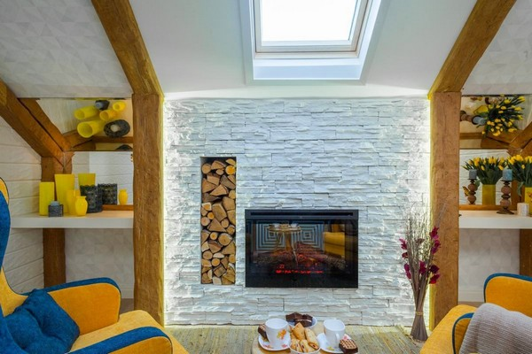4-cheerful-blue-yellow-white-attic-bedroom-interior-design-ceiling-beams-3D-walls-artificial-stone-fireplace-surround-skylight