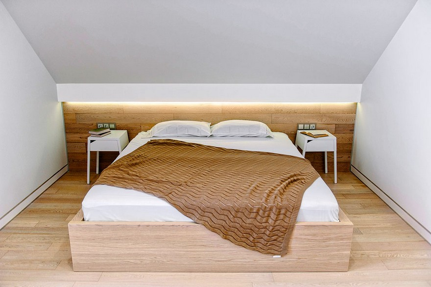 5-white-beige-minimalist-Scandinavian-style-house-interior-design-bedroom-sloped-ceiling-parquet-boards-on-the-wall-backlit-headboard-LED-band-bedspread