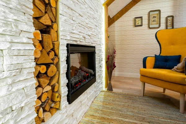6-cheerful-blue-yellow-white-attic-bedroom-interior-design-ceiling-beams-3D-walls-artificial-stone-fireplace-surround-leather-mat