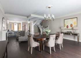 0-contemporary-style-open-concept-dining-room-lounge-interior-design-gray-beige-brown-fireplace-capitone-arm-chairs-oval-table-dark-floor-3D-walls-staircase-townhouse