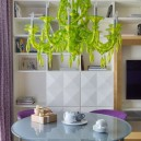 00-living-dining-room-interior-design-with-art-decor-style-elements-geometrical-3D-cabinets-shelving-unit-bright-lattuce-green-chandelier-purple-curtains-chairs-glass-coffee-table