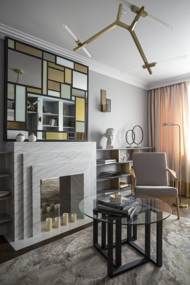1-gray-pink-beige-French-style-living-room-interior-design-with-art-deco-elements-shelving-unit-arm-chairs-faux-fireplace-candles-lamps-mirror-wall-decor-concealed-TV-set-floor-lamp