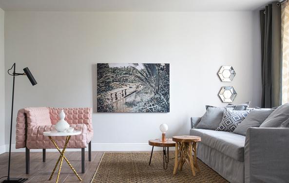 1-minimalist-style-studio-apartment-interior-design-open-concept-white-walls-living-room-gray-IKEA-sofa-pale-pink-asymmetrical-Inga-Sempe-arm-chair-hexagonal-mirrors-wooden-coffee-tables-jute-rug