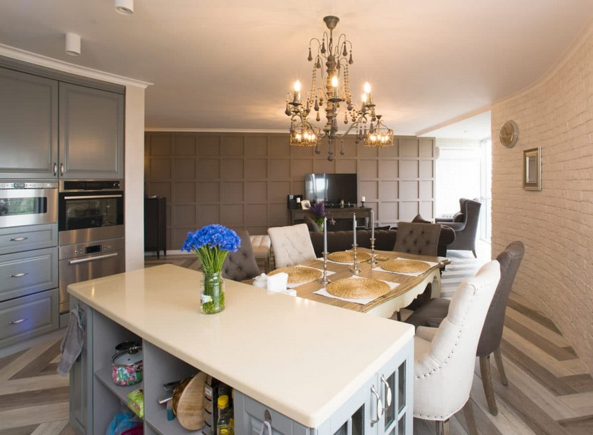1-white-gray-brown-French-style-open-concept-living-dining-room-kitchen-interior-design-faux-brick-plaster-3D-chocolate-MDF-wall-chandelier-island-table-mismatched-chairs