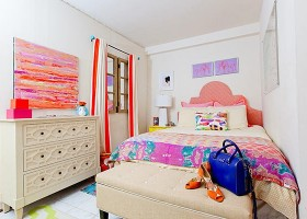 1-white-walls-bright-orange-yellow-accents-windowless-bedroom-room-interior-design-faux-window-upholstered-bed-stripy-curtains-ottoman-chest-of-drawers-paintings