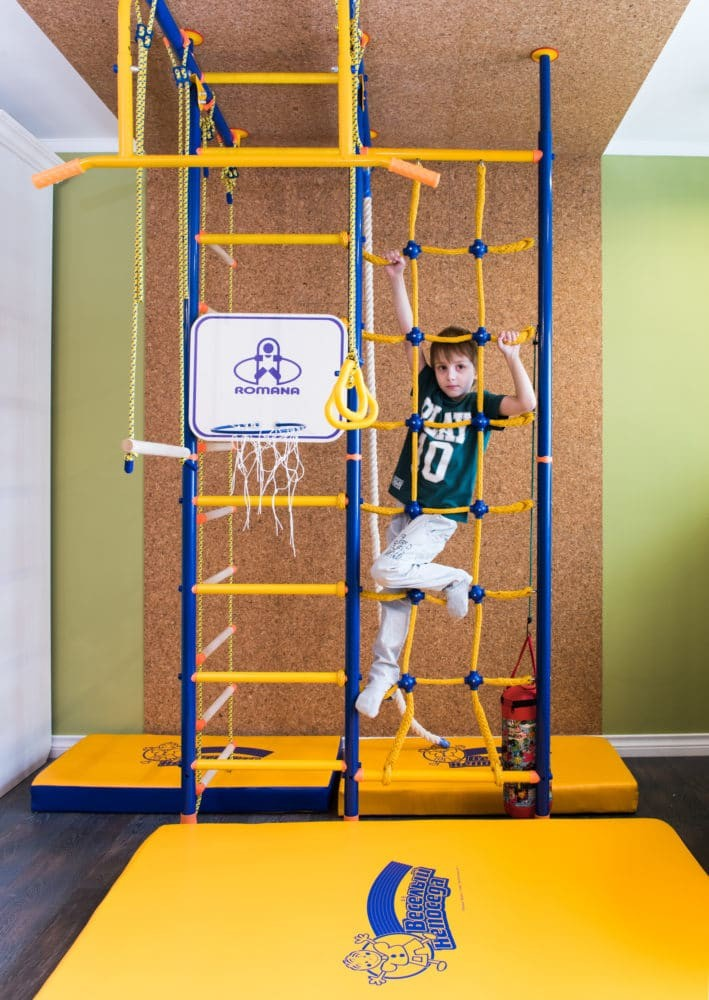 10-green-and-yellow-toddler-room-kid's-bedroom-interior-design-sports-corner-corkwood-wall-climbing-frame