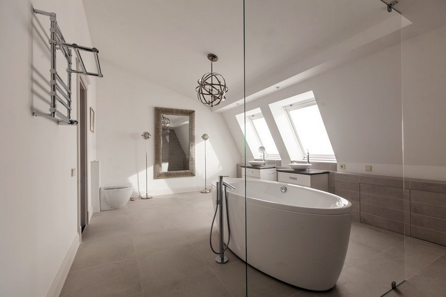 13-spacious-big-minimalist-bathroom-interior-design-two-wash-basins-cabinets-oval-bath-bathtub-glass-shower-cabin-attic-sloped-ceiling-two-skylights-mirror